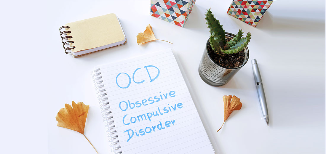 OCD Obsessive Compulsive Disorder written in notebook on white table